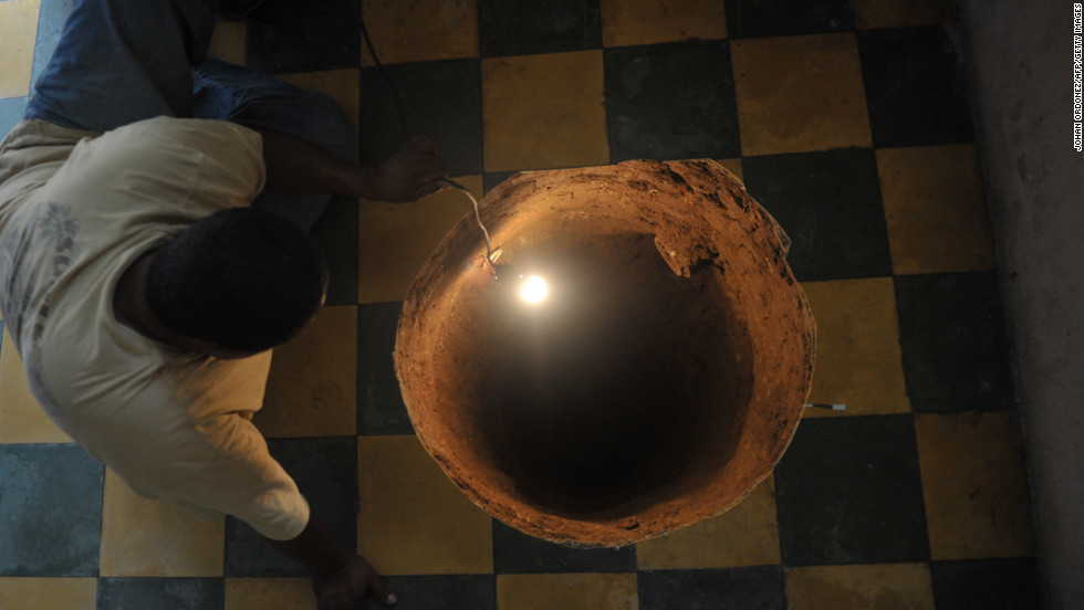 Sinkhole in florida swallows up house threatens others cnn in july 2011 a man inspects a 40 foot deep sinkhole that a workwithnaturefo