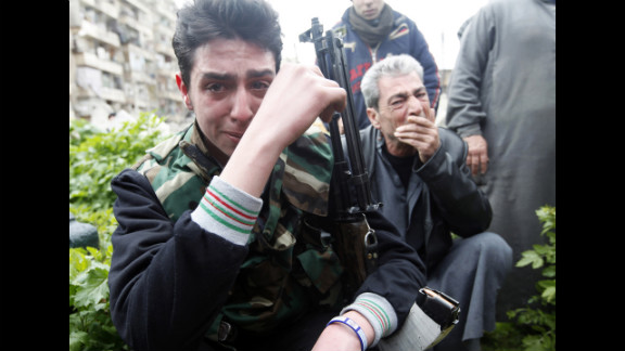 A member of the Free Syrian Army reacts to the death of a comrade who was killed in fighting, at Bustan al Qasr cemetery in Aleppo on Friday, March 1.
