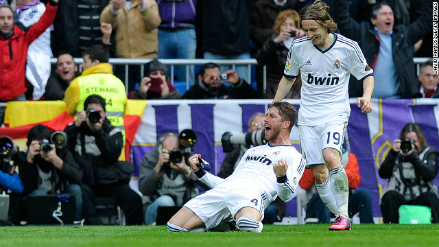 Sergio Ramos (left) celebrates with Luka Modric after scoring Real Madrid's second goal against Barcelona on Saturday.