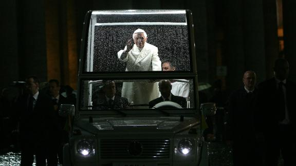 Pope Benedict XVI waves as he arrives in St. Peter
