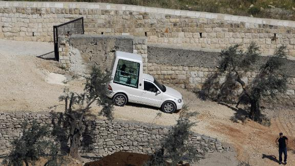 An Israeli worker drives the Popemobile during a rehearsal on May 6, 2009 at the foot of the Mount of Olives in Jerusalem. Israel