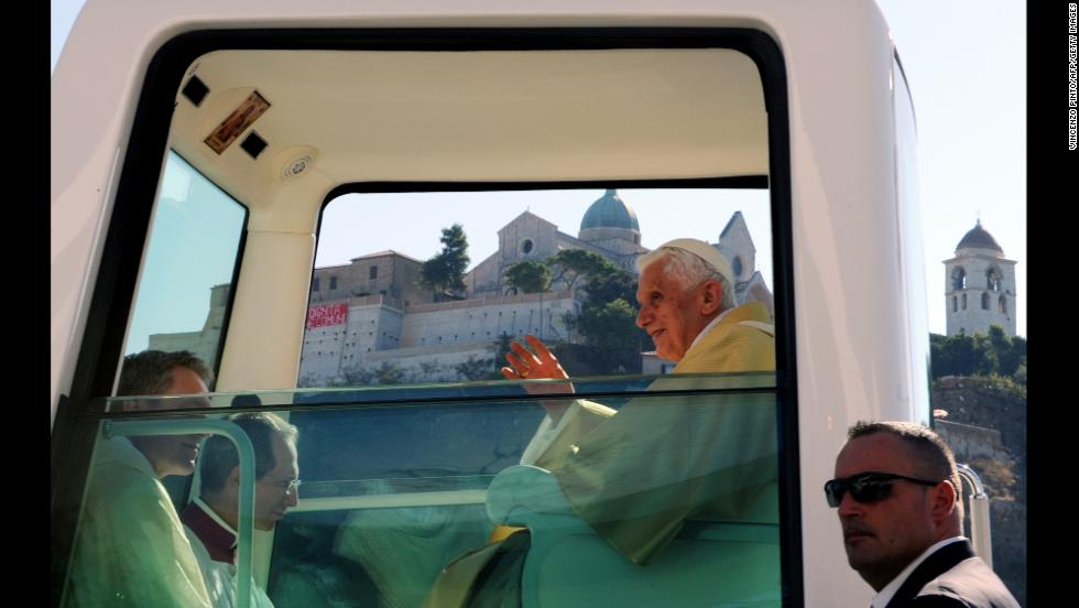 This Popemobile (photographed in September 2011) is fitted with a religious image just above the pope's seat.