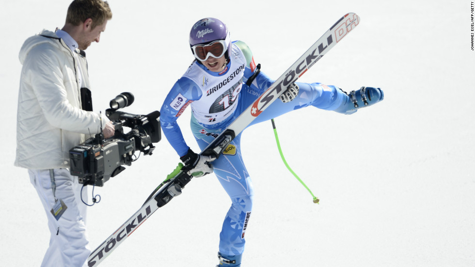 Maze uses her ski as a mock guitar after winning the downhill in Garmish Partenkirchen to break the 2,000-point World Cup record.