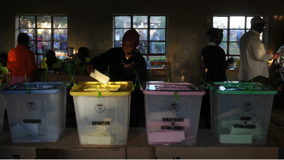 A voter puts a ballot paper into the senatorial box as voting kicked off in Kenya on March 4, 2013 in the country