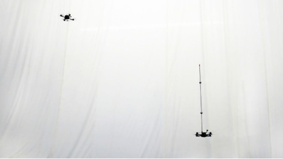 At the Flying Machine Arena, two quadrocopters prepare to perform ...