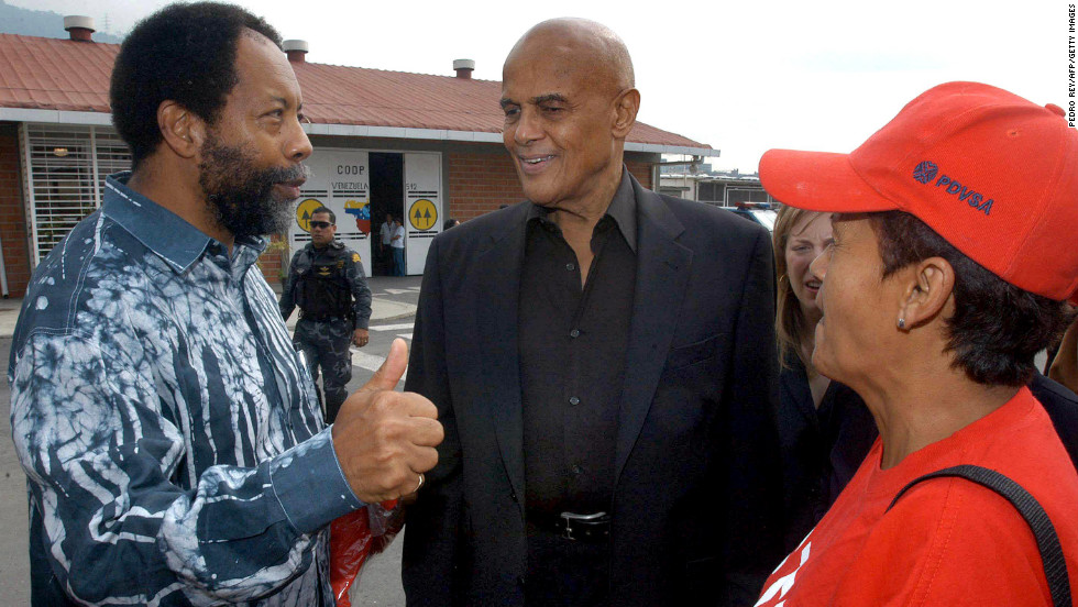 "In 2006, singer Harry Belafonte appeared in Venezuela with then-President Hugo Chavez and made controversial statements about Bush: ""No matter what the greatest tyrant in the world, the greatest terrorist in the world, George W. Bush says, we're here to tell you: Not hundreds, not thousands, but millions of the American people support your revolution."" In this photo, Belafonte, center, speaks with residents of a low-income neighborhood in Caracas, Venezuela, before meeting Chavez in January 2005."