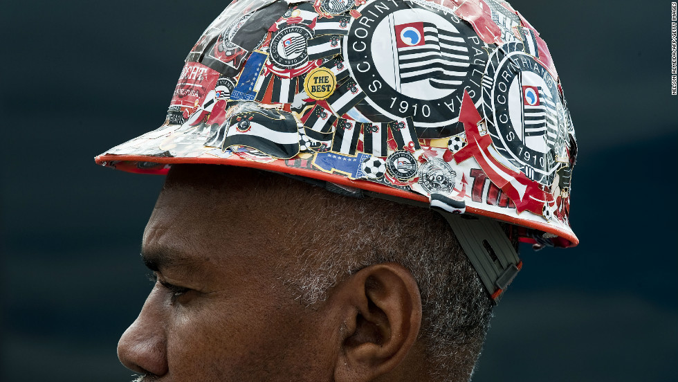 A construction worker at the site of the Itaquerao football stadium which will host the opening football matches of the FIFA World Cup 2014 in Sao Paulo, Brazil.