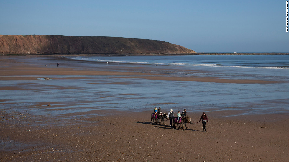 Tourists enjoy donkey rides on Filey Beach on March 2 in Filey, England.