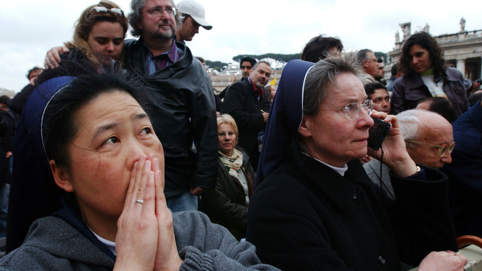 Nuns wait for the announcement of the name of the new pope after white smoke rose from the Sistine Chapel signaling a pope had been elected during the second day of the conclave on April 19, 2005.