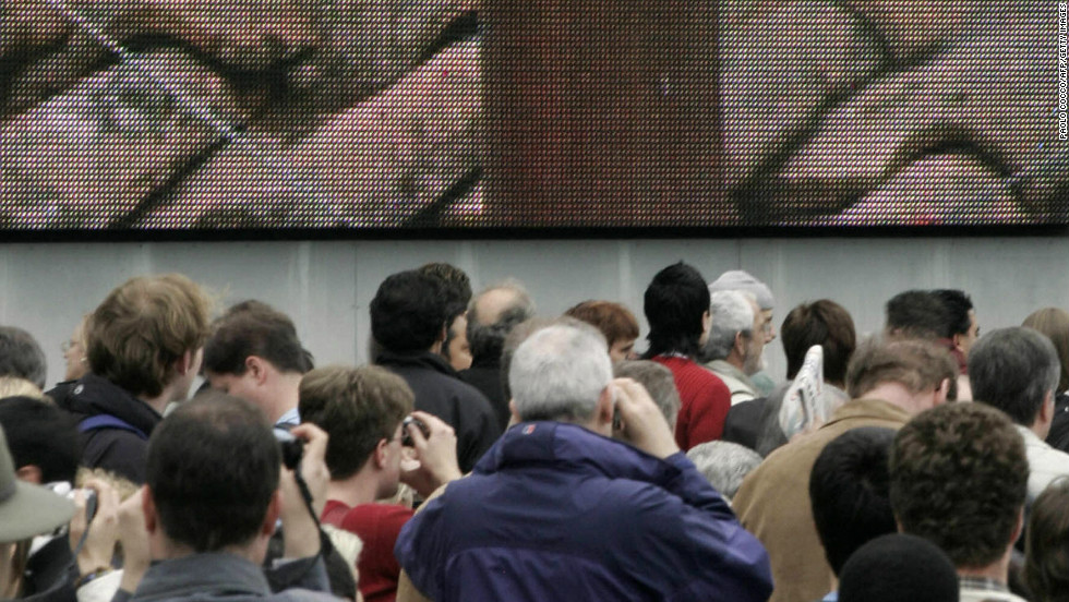 In 2005, crowds of people gathered in front of a giant screen showing the Sistine Chapel chimney.