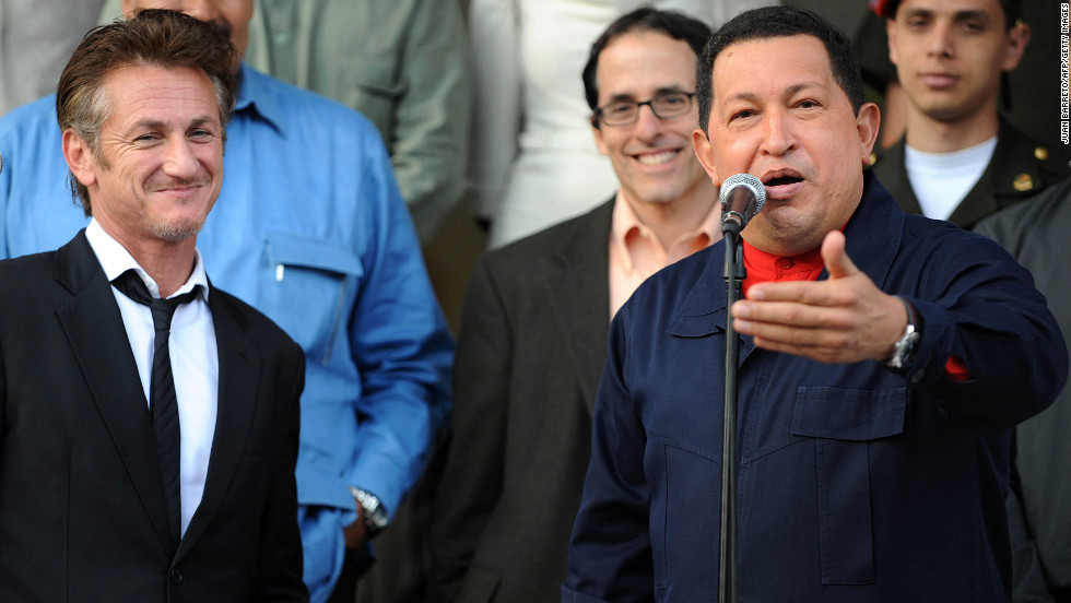 Venezuelan President Hugo Chavez greets actor Sean Penn after a meeting at the Miraflores presidential palace in Caracas on March 5, 2011. Penn thanked Chavez for the support given by the Venezuelan government to his nongovernmental organization, which benefits victims of the 2010 Haiti earthquake.