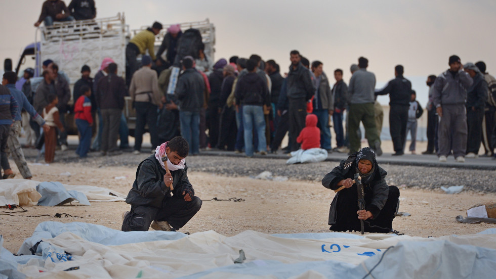 Syrians put up tents at the Zaatari refugee camp in January 2013.