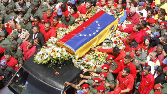 Members of the military escort Chavez's casket down the streets of Caracas on March 6.
