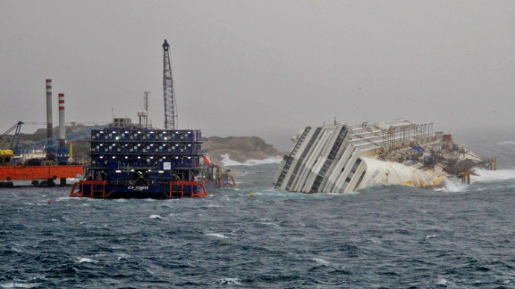 The five story-high block of floating flats, pictured left, houses the divers working around the clock on the salvage operation.