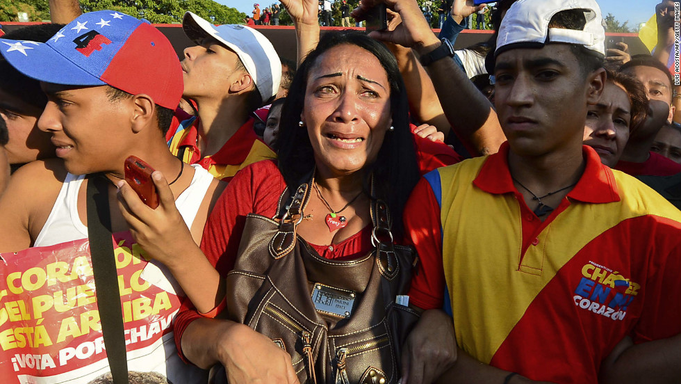 Throngs of Chavez supporters accompany the coffin of the deceased Venezuelan president as it arrives at the Military Academy in Caracas on March 6.