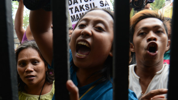 Members of Philippine women's group Gabriela near the gates of Malacanang palace in Manila on March 7, 2013.