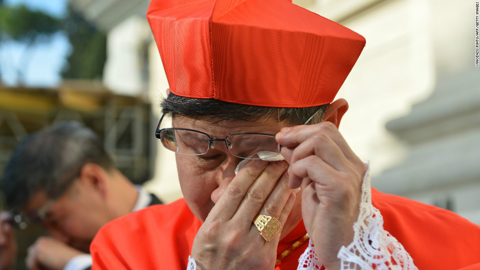 Luis Antonio Tagle cries after the ceremony where he was appointed by the pontiff as cardinal on November 24, 2012 at St. Peter's Basilica at the Vatican.