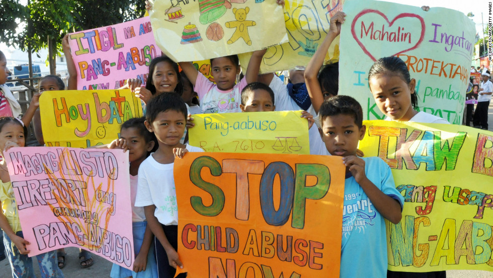Child abuse cases in the Philippines, by priests and non-clergy alike, have plagued the Asian nation just as in Europe and North America. Here, children in Manila carry signs calling for the end of child abuse in a parade marking United Nations Children's Month, October 2008.