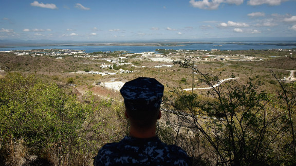 A Navy sailor surveys the base in October 2009. In December 2013, Congress passed a defense-spending bill that makes it easier to transfer detainees out of the facility.
