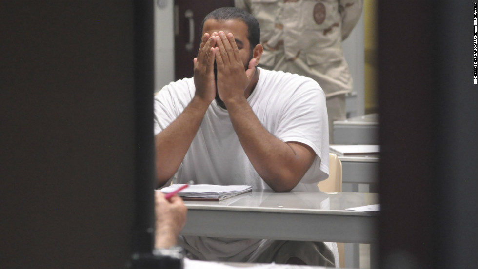 "A detainee rubs his face while attending a ""life skills"" class in April 2009."