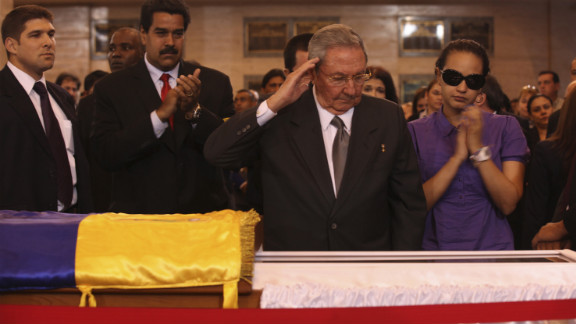 Cuban President Raul Castro salutes Chavez's body as he visits the wake with Chavez's daughter, Rosa Virginia, right, and Venezuela's Vice President Nicolas Maduro on Thursday, March 7.