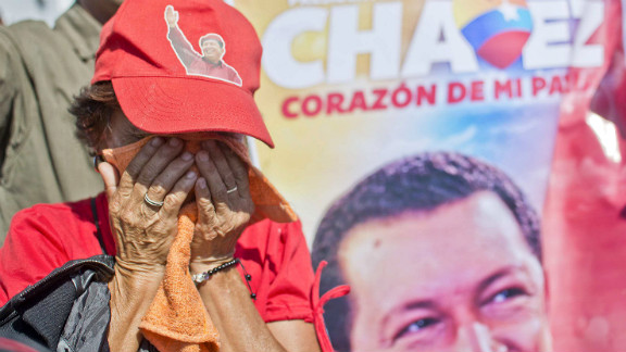 A Chavez supporter weeps outside of his funeral in Caracas on March 8.