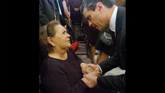 Mexican President Enrique Pena Nieto, right, talks to Elena Frias, Chavez's mother, on March 8.