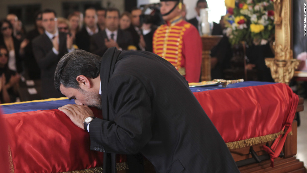 Iran's President Mahmoud Ahmadinejad pays tribute to late Venezuelan President Hugo Chavez during the funeral in Caracas, Venezuela, on Friday, March 8.