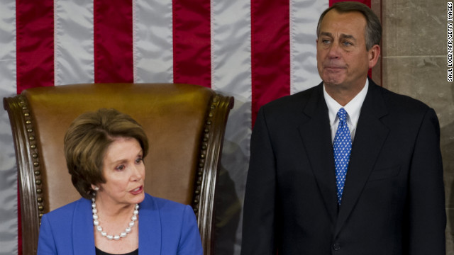 US Representative John Boehner, Republican of Ohio, reacts after being re-elected as Speaker of the House alongside US Representative Nancy Pelosi, Democrat of California and returning Minority Leader, during the opening session of the 113th US House of Representatives at the US Capitol in Washington, DC, on January 3, 2013.