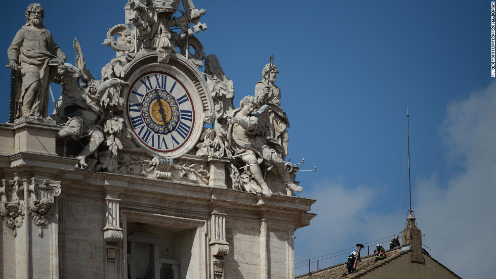 Vatican City firefighters set up the chimney on the roof of the Sistine Chapel on March 9 ahead of the papal conclave.