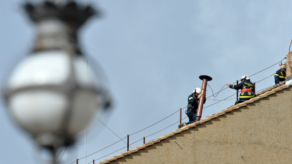Vatican workers made final preparations on the Sistine Chapel on March 9.