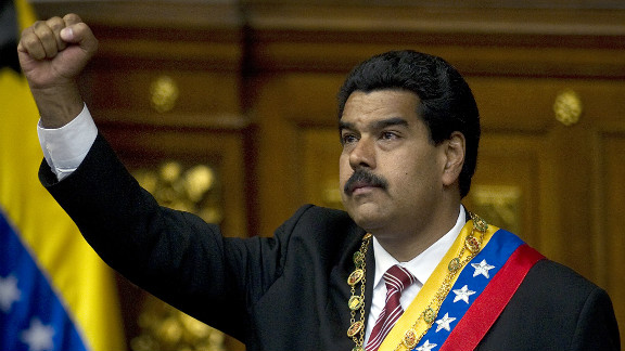 Venezuelan acting president Nicolas Maduro clenches his fist after he was sworn in, in Caracas, on March 8, 2013.