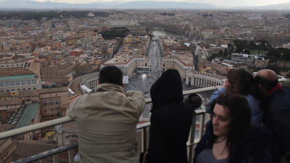 Tourists take in the view from the cupola on St. Peter's Basilica on March 10.