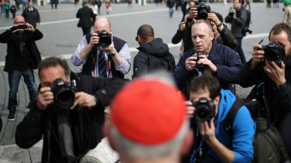 Canadian Cardinal Marc Ouellet is photographed by media as he leaves the final congregation on March 11.