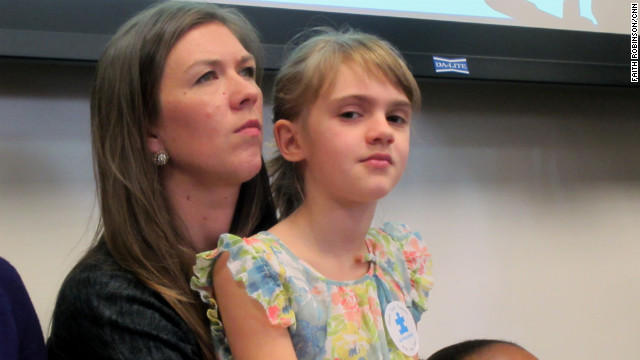 Ava Bullard, 8, sits with her mom, Anna, at a hearing of the insurance committee of the Georgia State Senate.