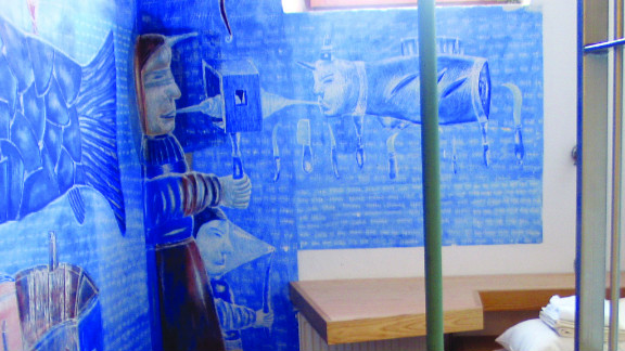 A mural by a Russian artist adorns the walls of a cell at Hostel Celica.