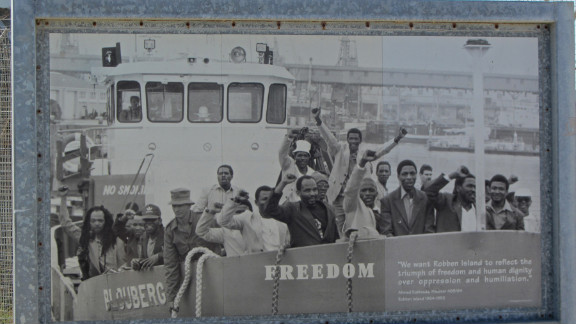 """Photograph of former Robben Island prisoners. Ahmed Kathrada, senior ANC leader and close friend of Nelson Mandela during their time in prison, said on their release, """"We want Robben Island to reflect the triumph of freedom and human dignity over oppression and humiliation."""""""