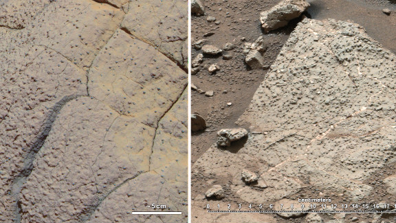 "The rock on the left, called ""Wopmay,"" was discovered by the rover Opportunity, which arrived in 2004 on a different part of Mars. Iron-bearing sulfates indicate that this rock was once in acidic waters. On the right are rocks from ""Yellowknife Bay,"" where rover Curiosity was situated. These rocks are suggestive of water with a neutral pH, which is hospitable to life formation."