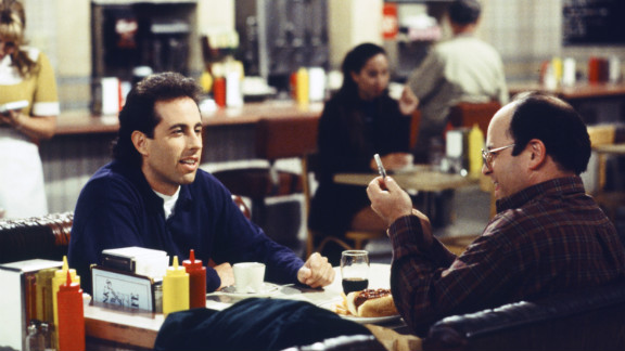 "True, ""Seinfeld"" also technically launched in 1989 -- but what are the '90s without Jerry Seinfeld (left), George Costanza (played by Jason Alexander, right), Kramer and ""The Elaine""?"