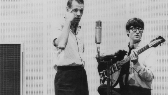 John Lennon is seen with Sir George Martin, often dubbed the fifth Beatle, the legendary Beatles producer, who first signed the Beatles to his Parlophone label when they were unknown. He then oversaw their rise to fame and who wrote or performed many of the orchestral arrangements in their songs.