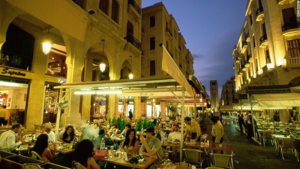 A row of outdoor restaurants in Beirut. Packed with family-style restaurants and street stalls, the capital is a good place to start.