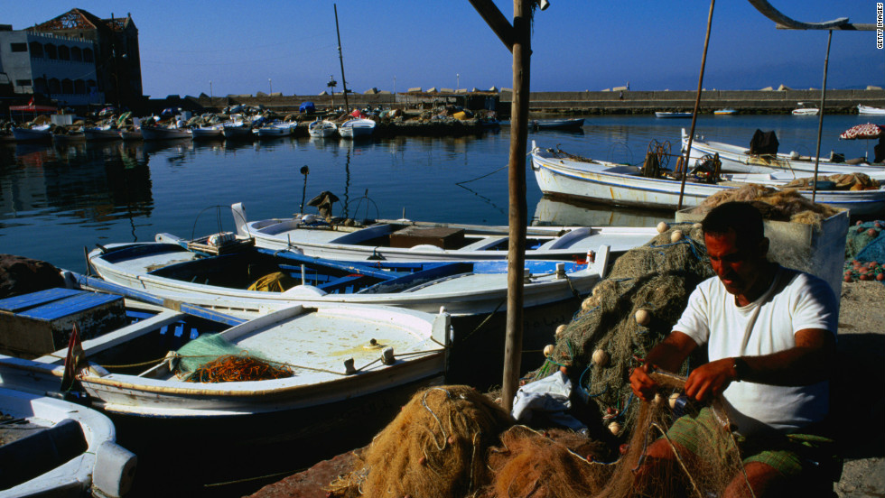 In Tyre, fishermen take boats out from the ancient harbor and return with fish to deliver to local restaurants.