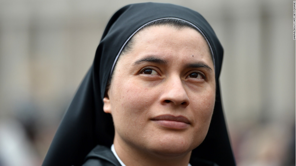 A nun waits for the results at the Vatican on March 13.