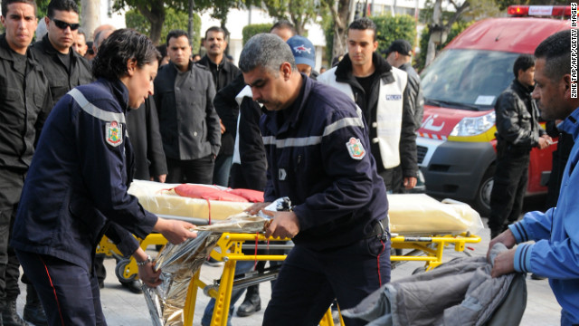 Tunisian paramedics rush to carry Adel Khadri, a cigarette vendor who immolated himself in Tunis on March 12, 2013.
