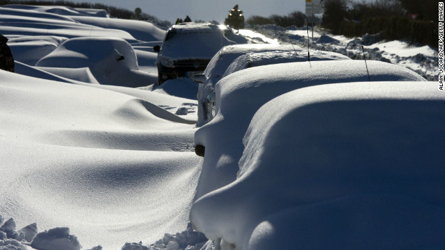 Cars covered in snow in northern France on Wednesday following a heavy snowstorm.