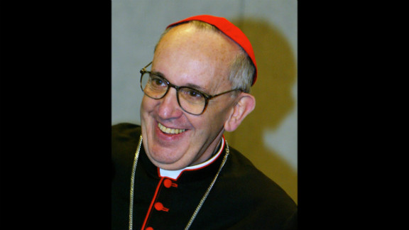 Bergoglio smiles during a news conference at the Vatican in October 2003. during celebrations marking the 25th anniversary of Pope John Paul II