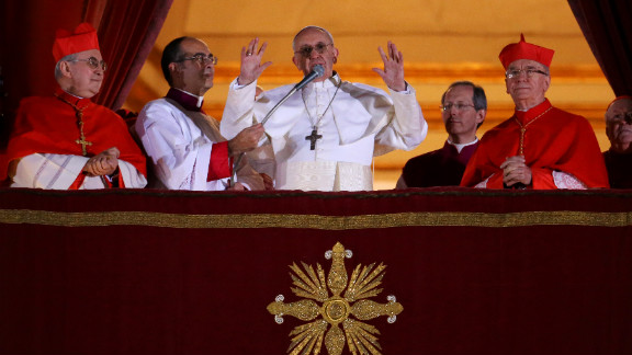 Newly elected Pope Francis speaks to the crowd from the central balcony of St. Peter