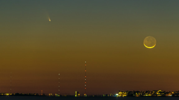 """Comet Pan-STARRS was visible to many stargazers on March 12. In Galveston, Texas, web designer Vadim Troshkin shot this photo for Galveston.com and said he was glad to see the comet during """"such a beautiful sunset."""""""