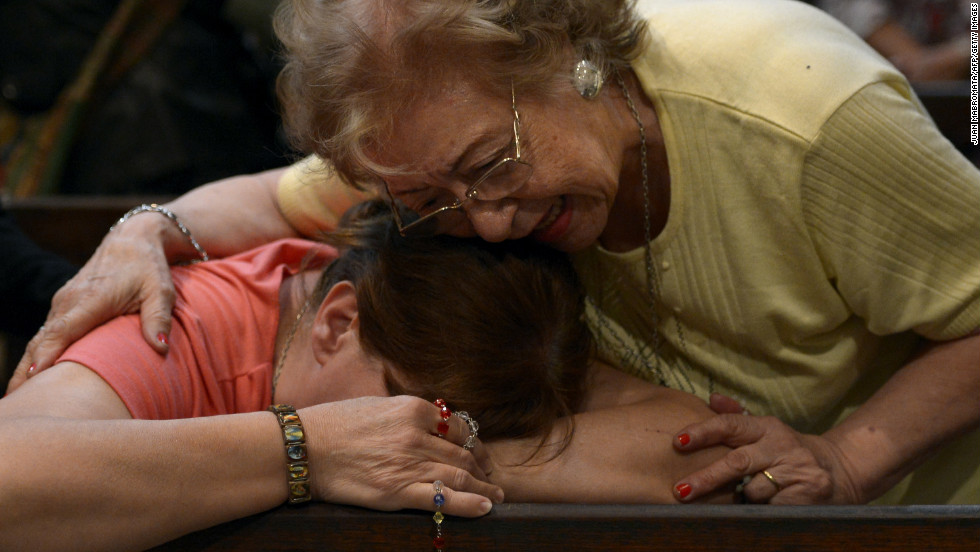 A woman is overcome with emotion at the Metropolitan Cathedral after the election.