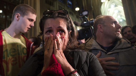 Shelly Guadelupe of Puerto Rico cries at St. Patrick's Cathedral in New York.